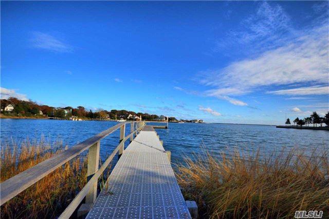 Photo of home for sale at 51 Rampasture Rd, Hampton Bays NY