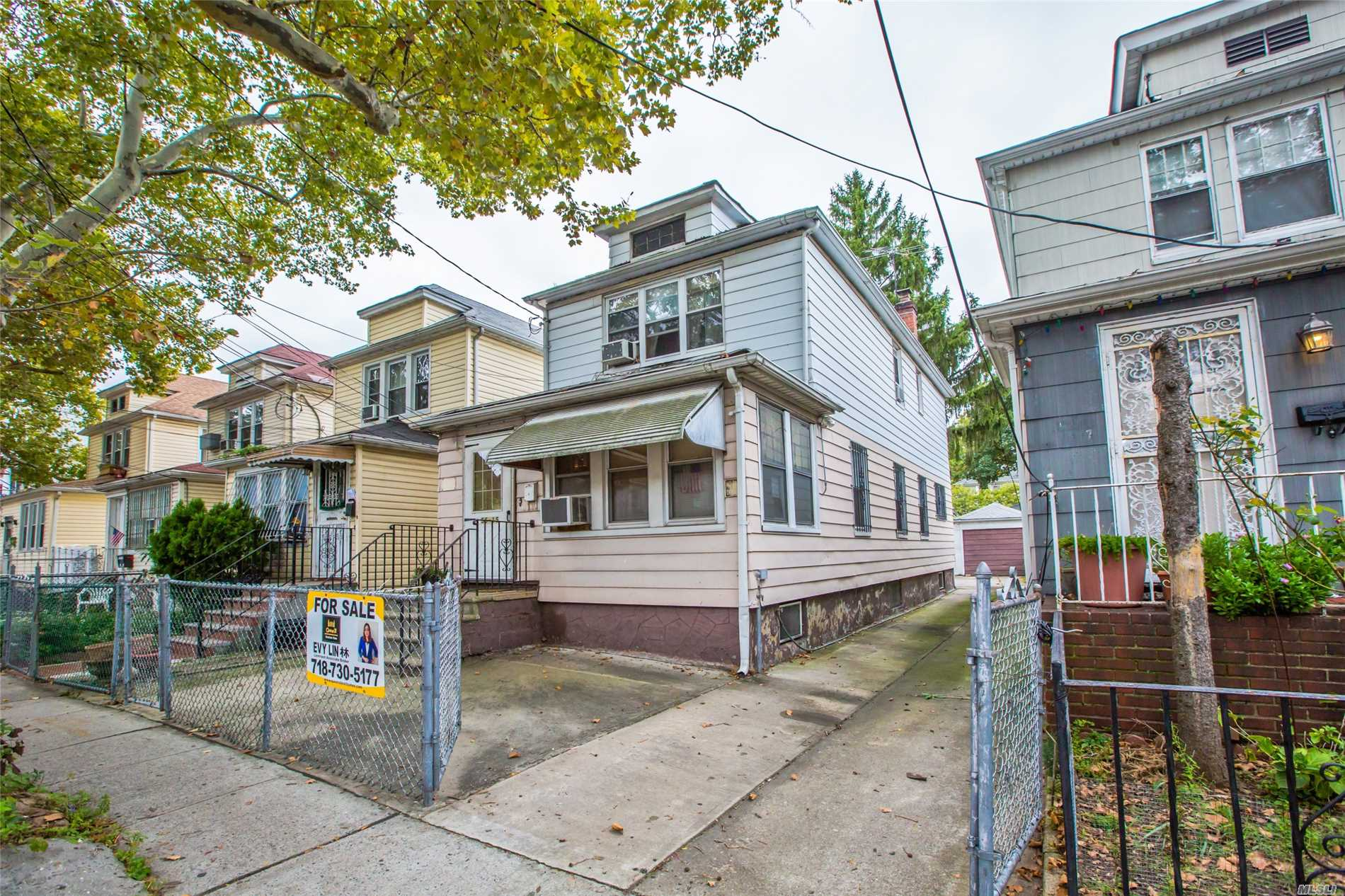 Photo of home for sale at 55-15 96th St, Corona NY
