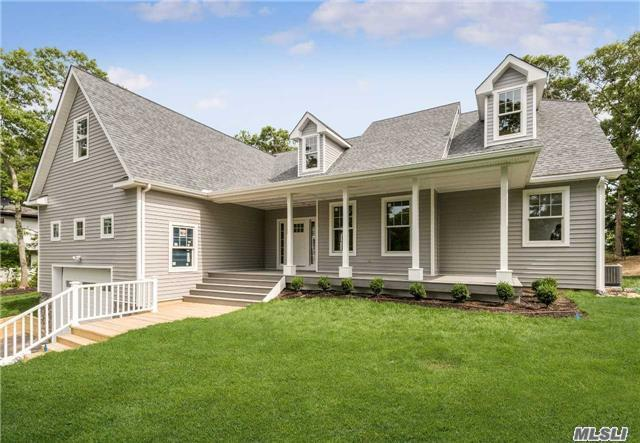 Photo of home for sale at 2 Rolling Woods Ln, Hampton Bays NY