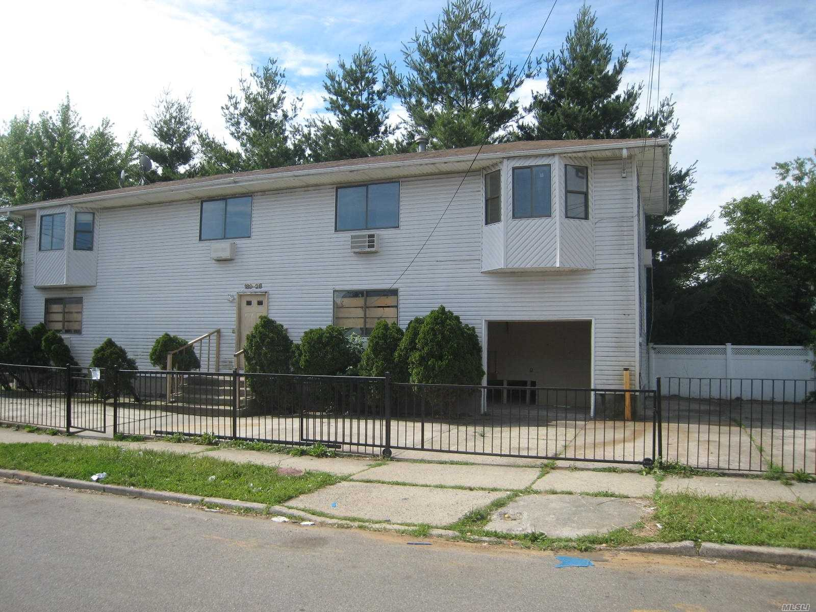 Photo of home for sale at 189-28 Quencer Rd, St. Albans NY