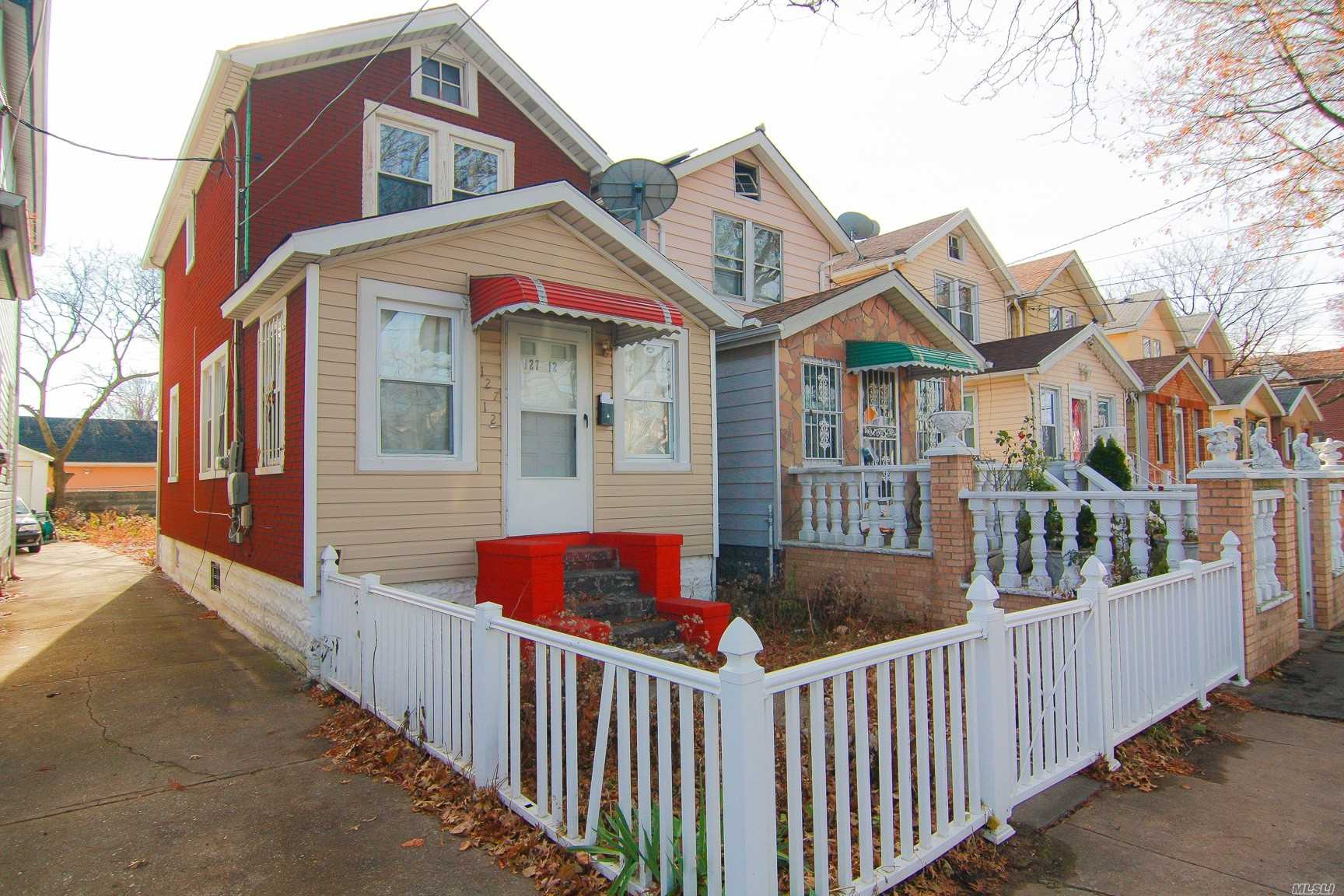 Photo of home for sale at 12712 116th Ave, Ozone Park NY
