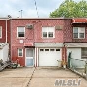 Photo of home for sale at 84-37 57 Rd, Elmhurst NY