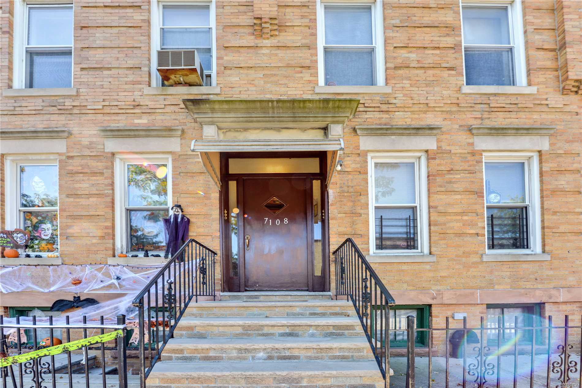 Photo of home for sale at 71-08 66th St, Glendale NY