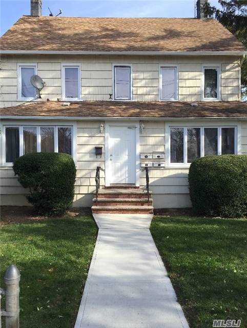 Photo of home for sale at 93 Bedell St, Freeport NY
