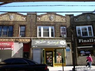 Photo of home for sale at 108-14 Jamaica Ave Ave, Richmond Hill NY