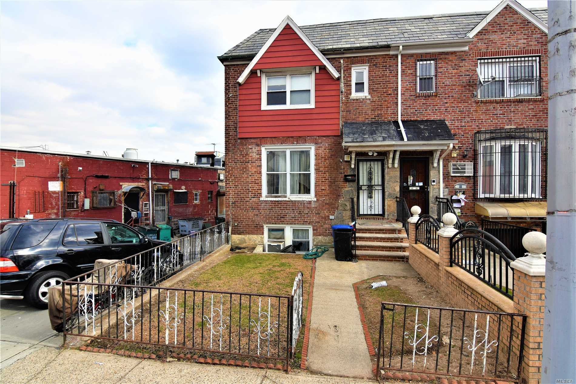 Photo of home for sale at 24-31 84th St, East Elmhurst NY