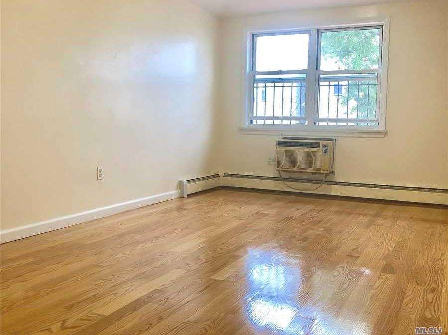 Photo of home for sale at 141-06 56 Avenue, Flushing NY