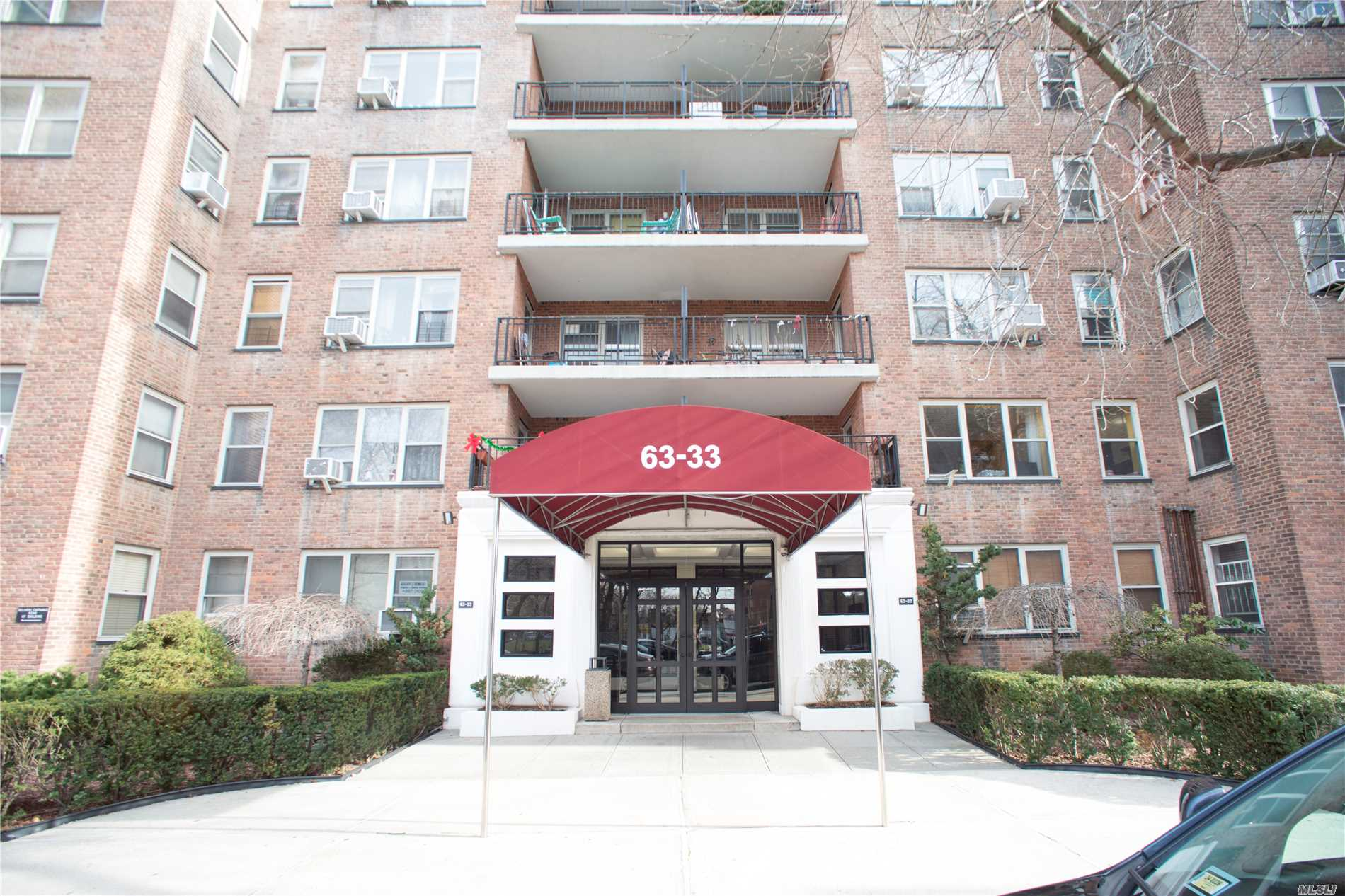 Photo of home for sale at 63-33 98th Pl, Rego Park NY