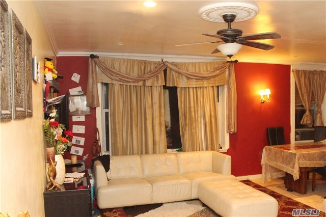 Photo of home for sale at 83-37 St. James Ave, Elmhurst NY