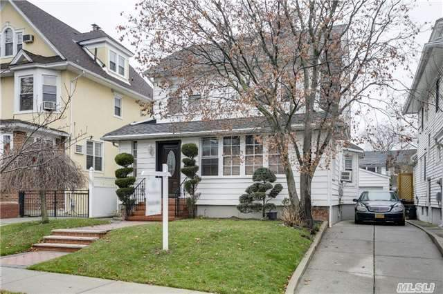 Photo of home for sale at 40-27 166th St, Flushing NY