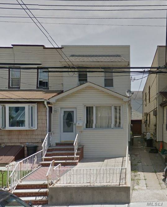 Photo of home for sale at 92-17 92nd St, Woodhaven NY