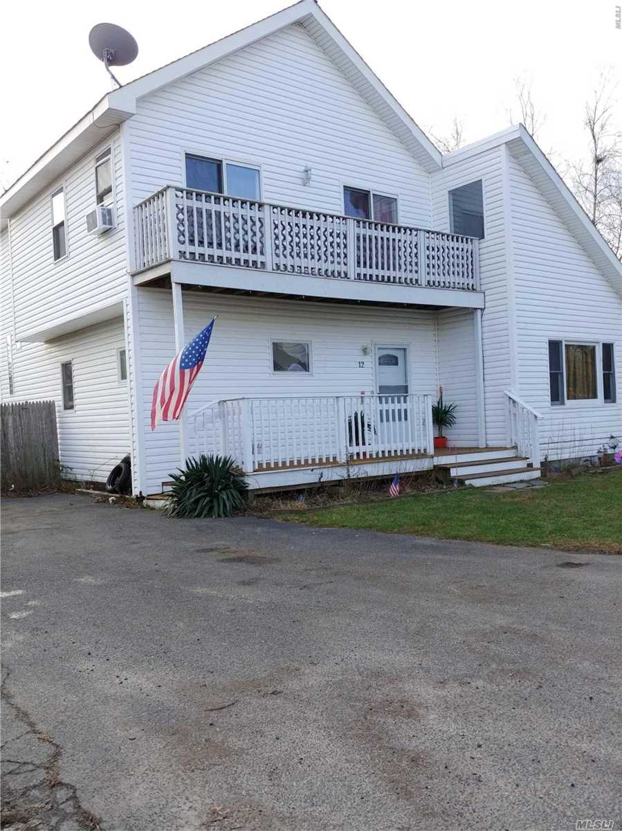 Photo of home for sale at 12 Narcissus Rd W, Mastic Beach NY