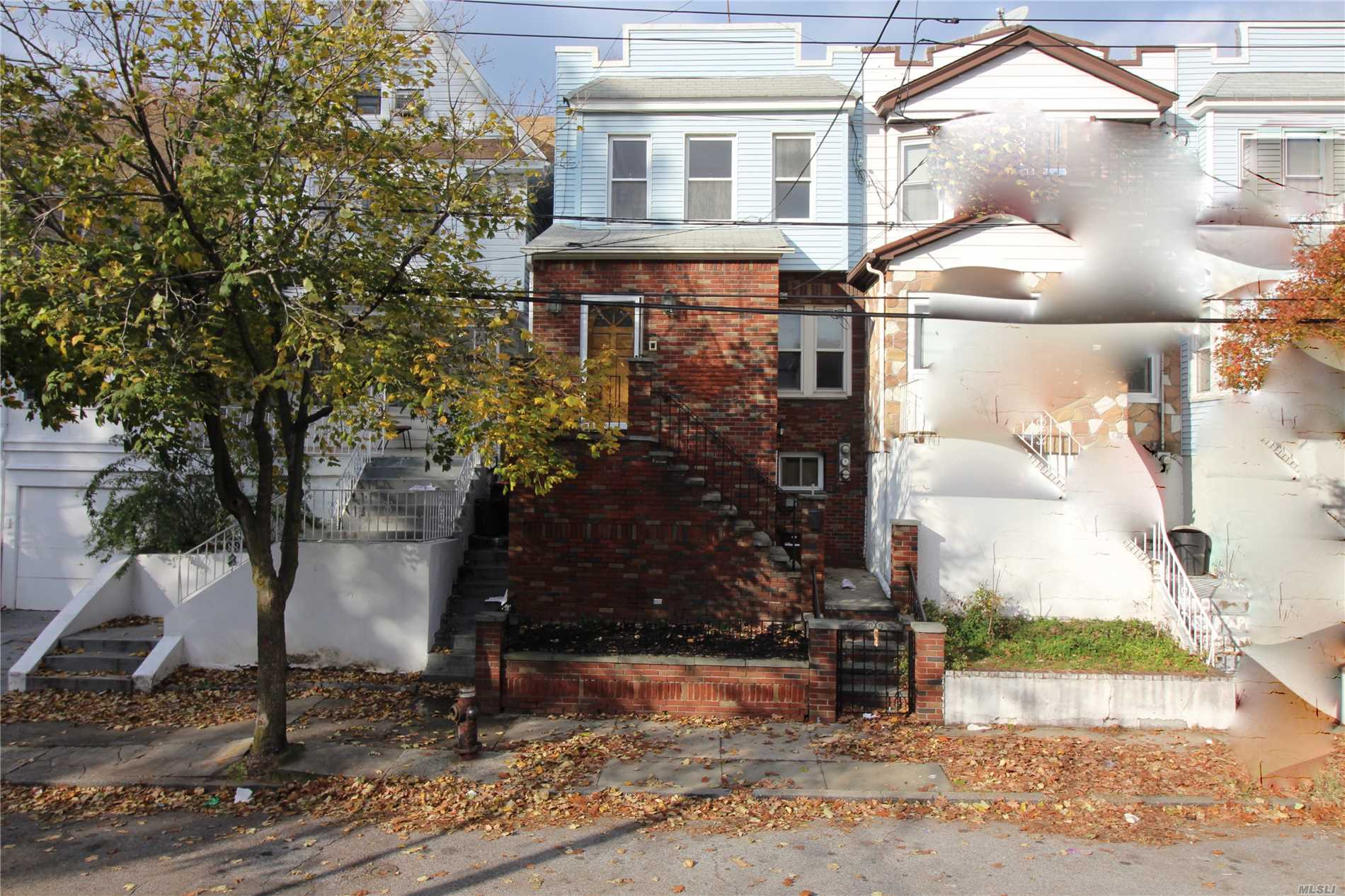 Photo of home for sale at 84-37 85th Ave, Woodhaven NY