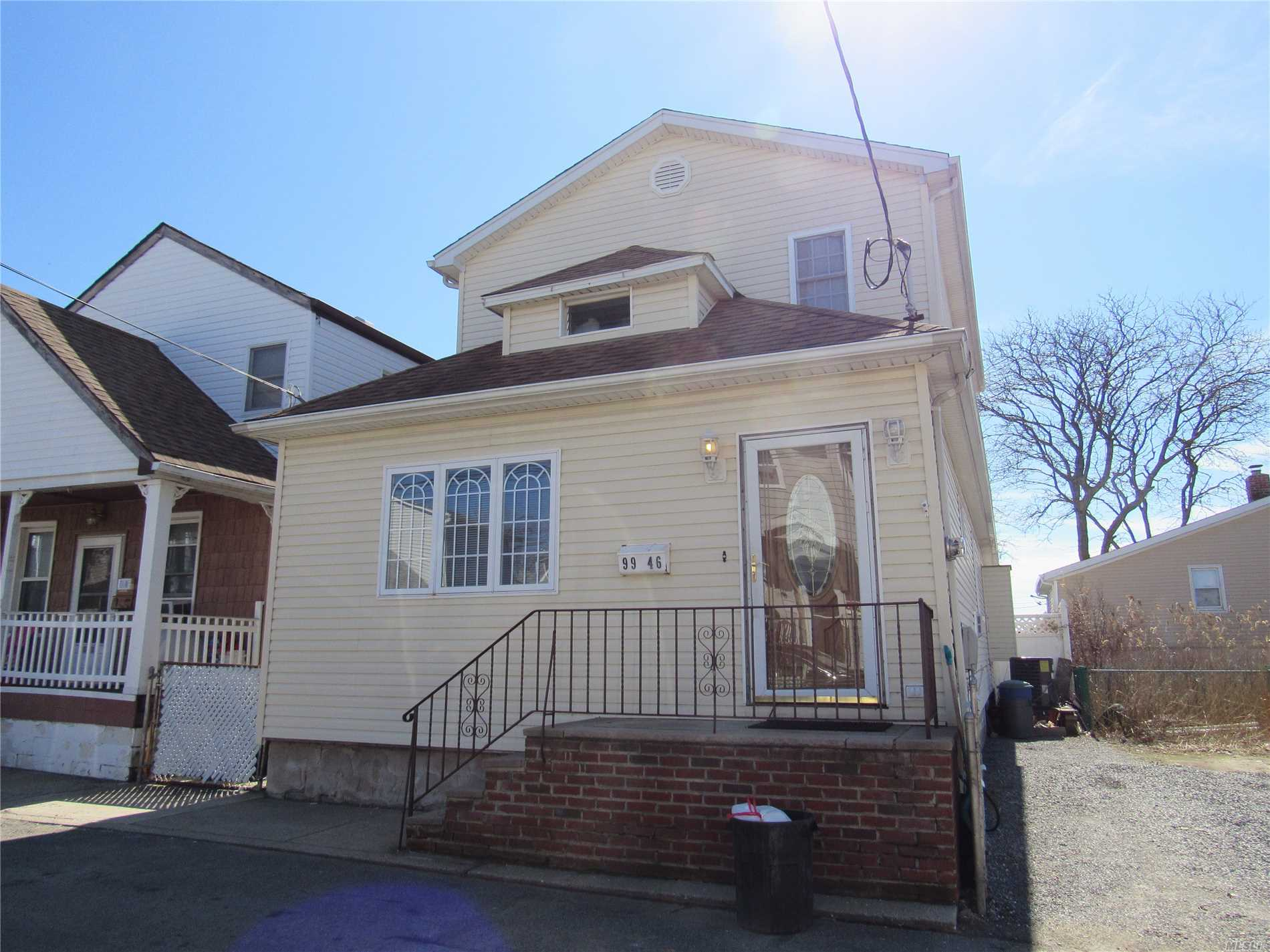 Photo of home for sale at 99-46 164 Ave, Howard Beach NY