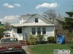 Photo of home for sale at 111 Jay St, Freeport NY