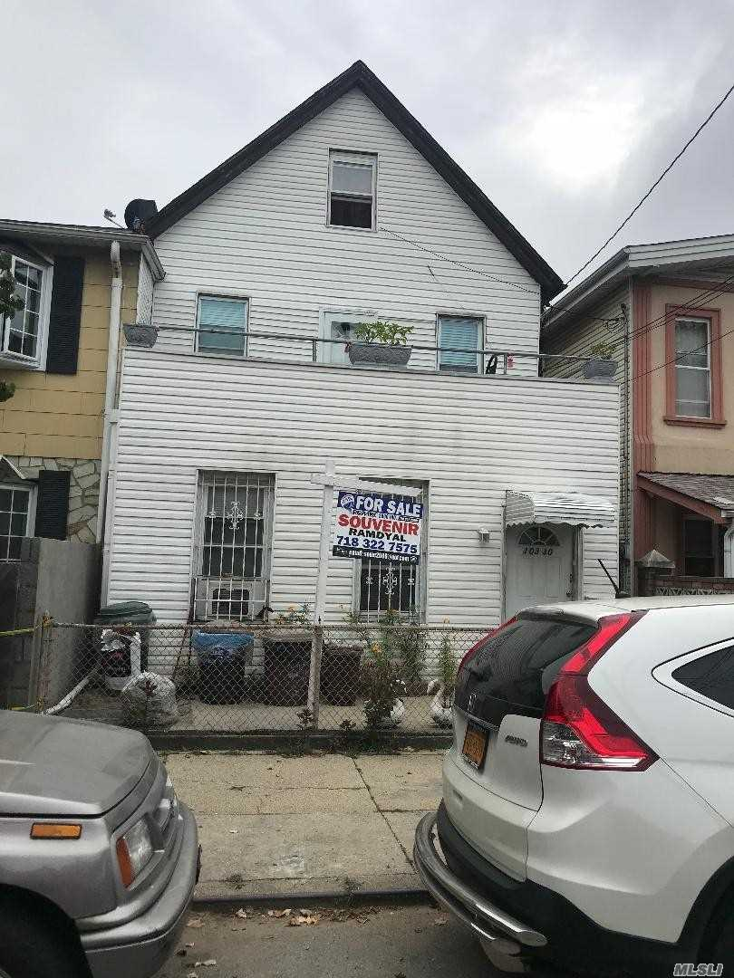 Photo of home for sale at 103-30 96th St, Ozone Park NY