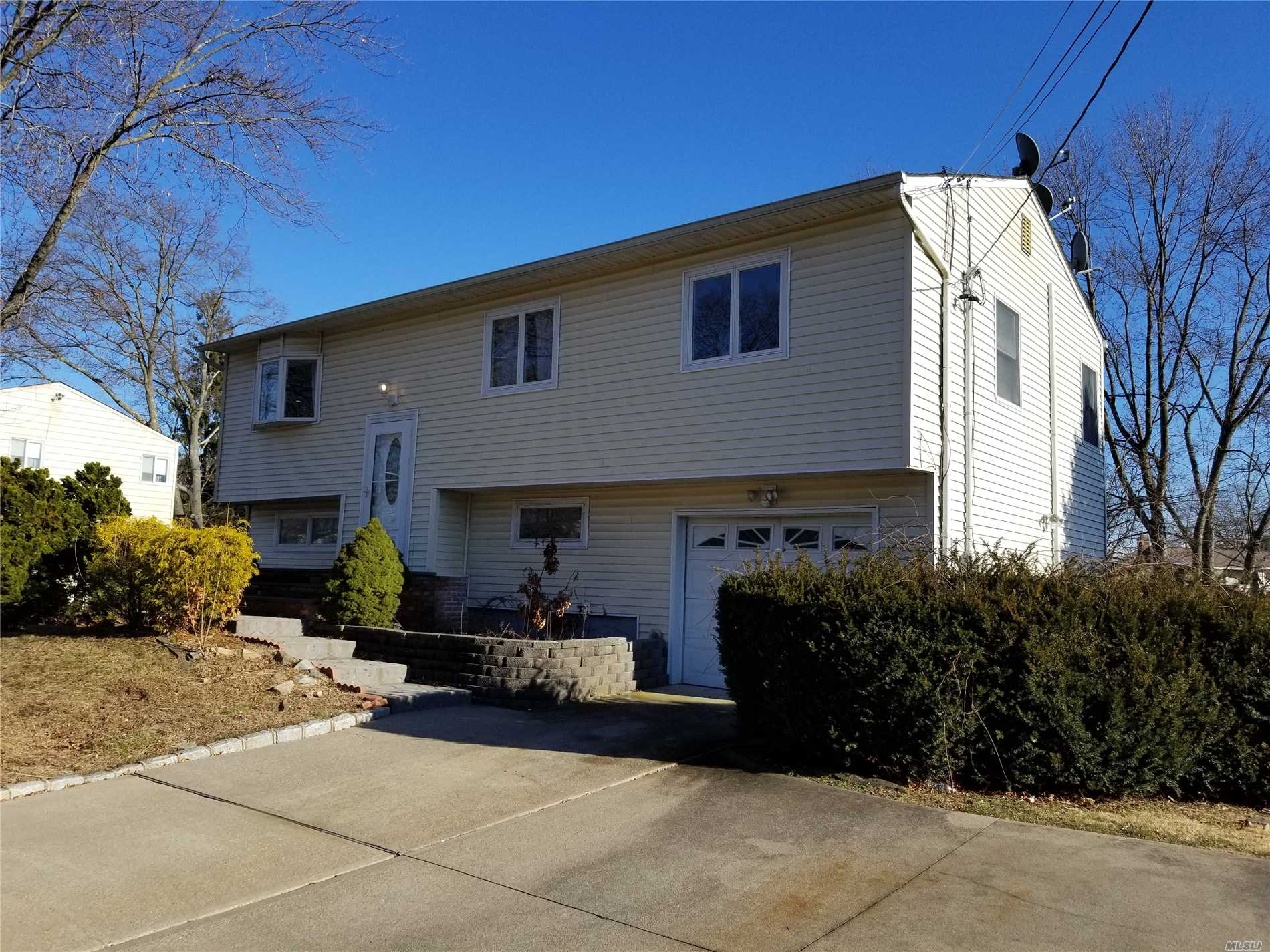 Photo of home for sale at 170 Ruland Rd, Selden NY