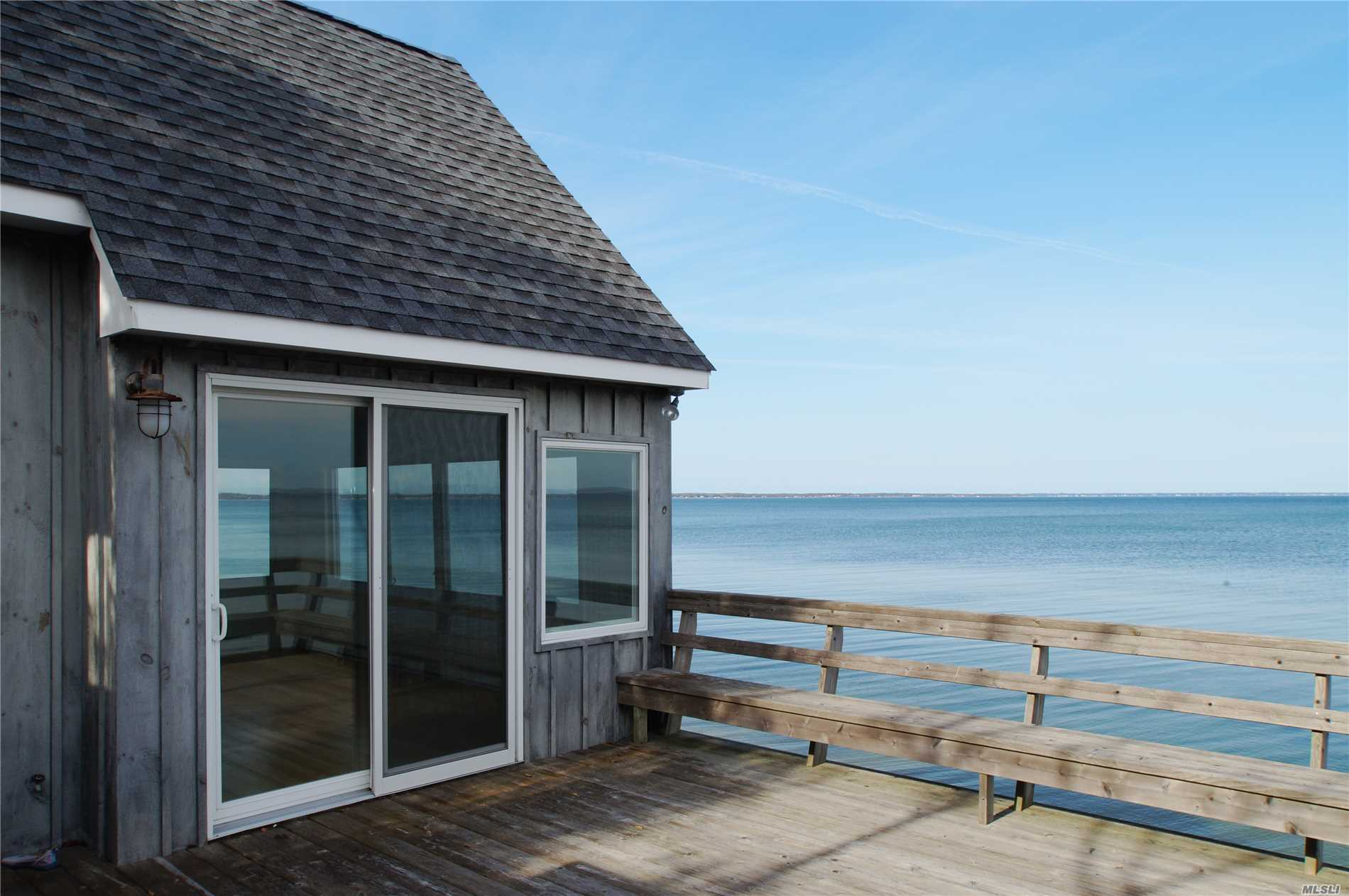 Photo of home for sale at 98/102 Red Creek Rd, Hampton Bays NY