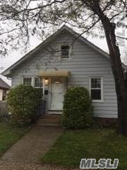 Photo of home for sale at 2 Harrison Ave, Freeport NY