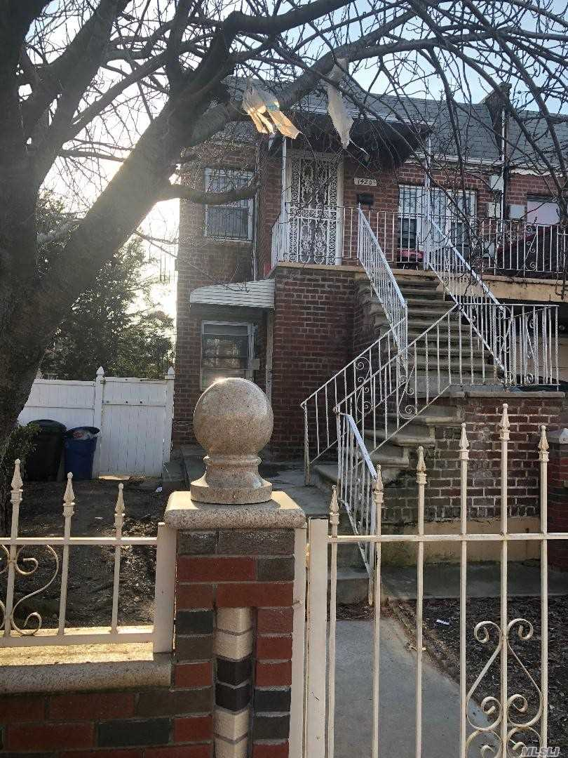Photo of home for sale at 1420 101st St E, Brooklyn NY