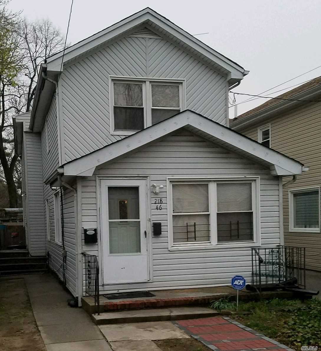 Photo of home for sale at 218-46 110th Ave, Queens Village NY