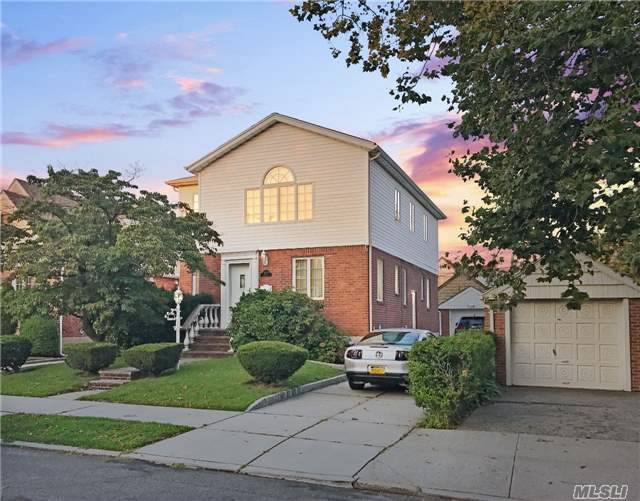 Photo of home for sale at 56-43 196th Pl, Fresh Meadows NY