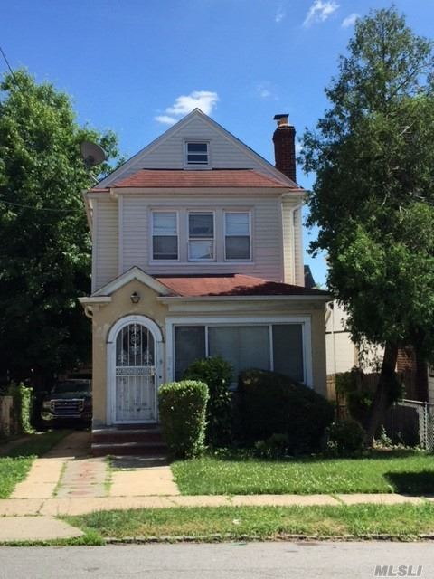 Photo of home for sale at 216-06 110 Ave, Queens Village NY