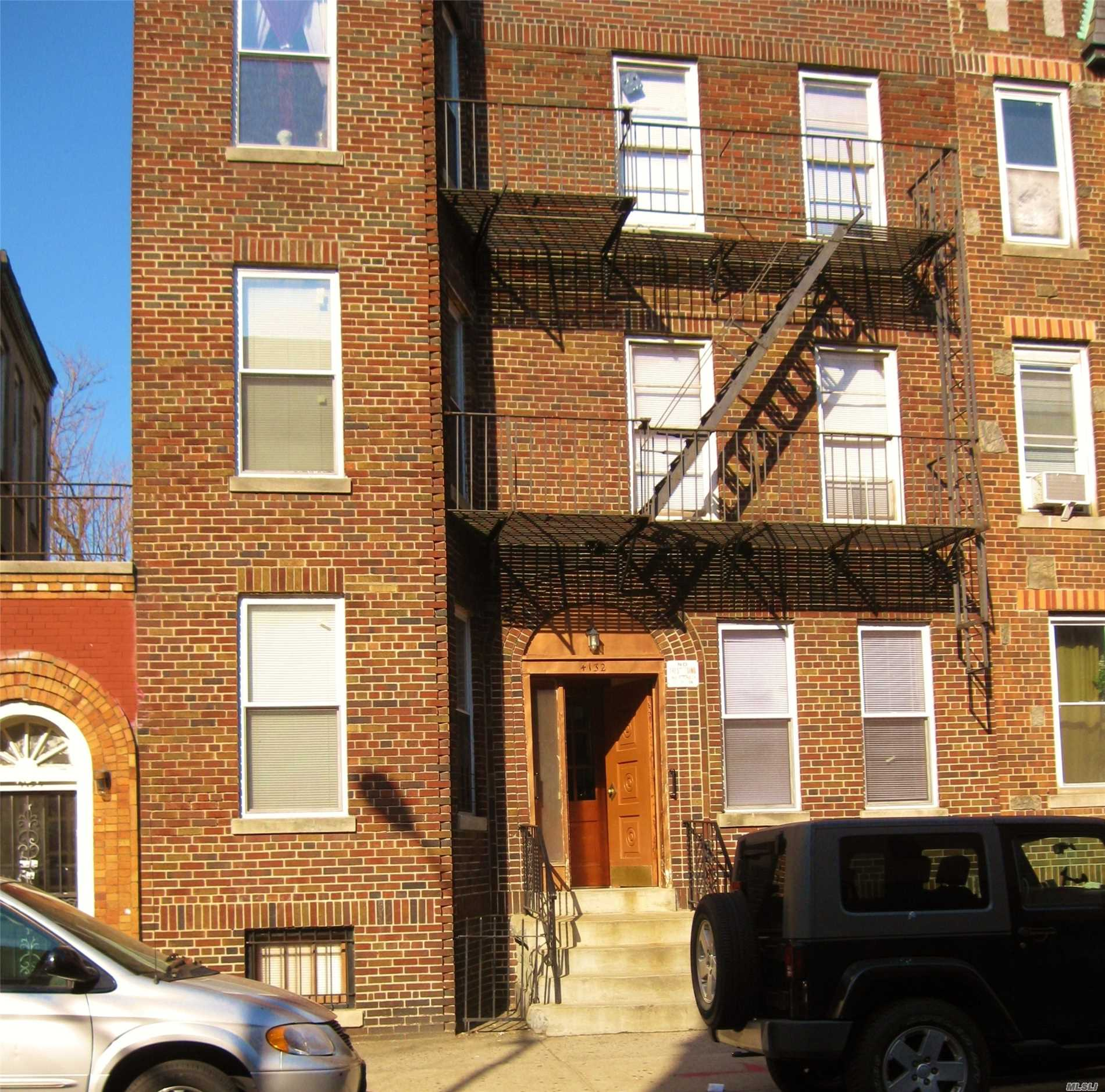 Photo of home for sale at 41-32 53rd St, Woodside NY
