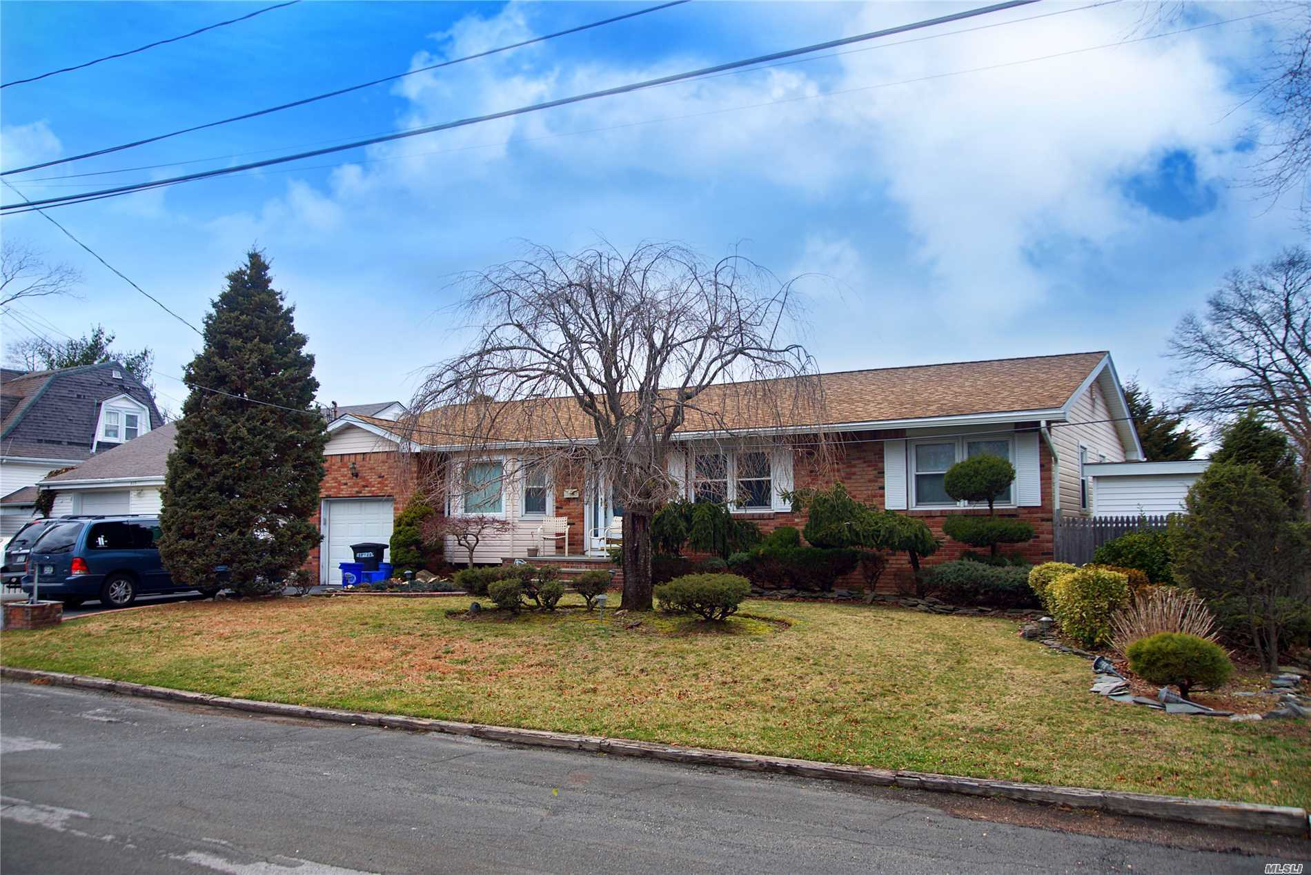 Photo of home for sale at 311 Walker St, West Babylon NY