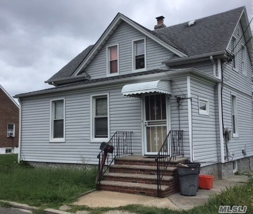 Photo of home for sale at 99 Roquette Ave, Elmont NY