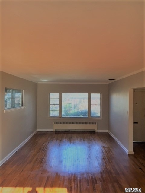 Photo of home for sale at 157-04 27th Ave, Flushing NY