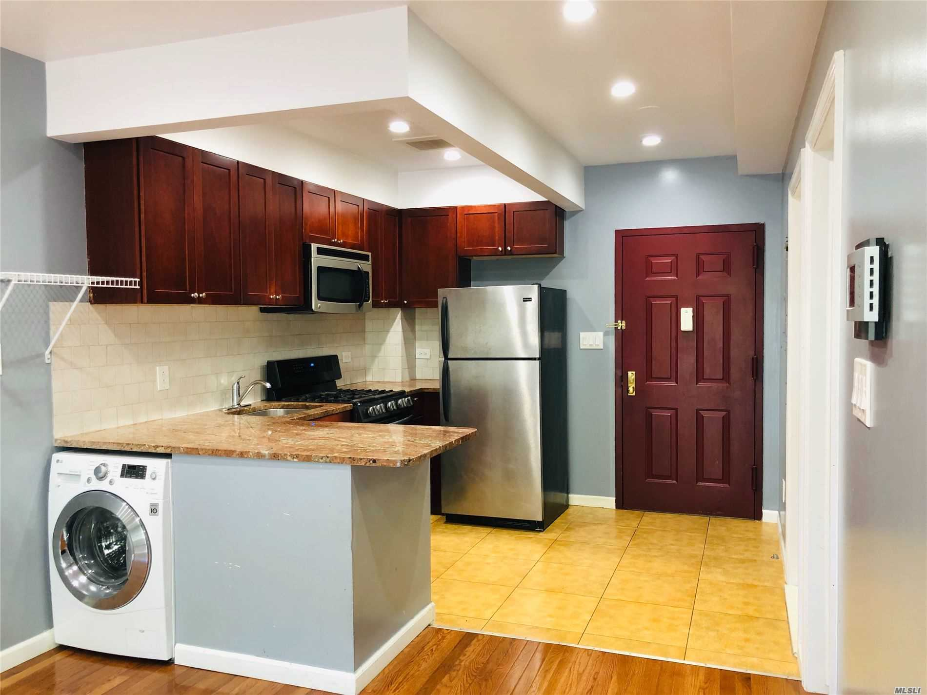 Photo of home for sale at 71-33 162nd St, Fresh Meadows NY