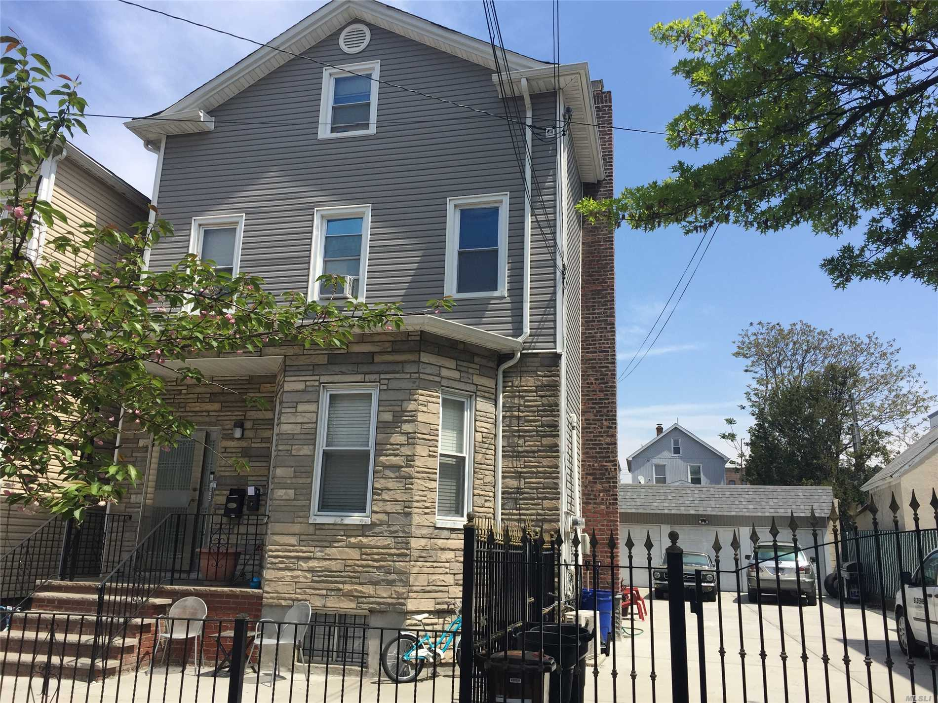 Photo of home for sale at 18-35 125th St, College Point NY