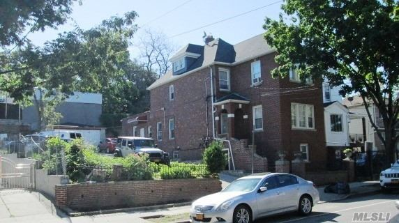 Photo of home for sale at 31-37 101st St, East Elmhurst NY