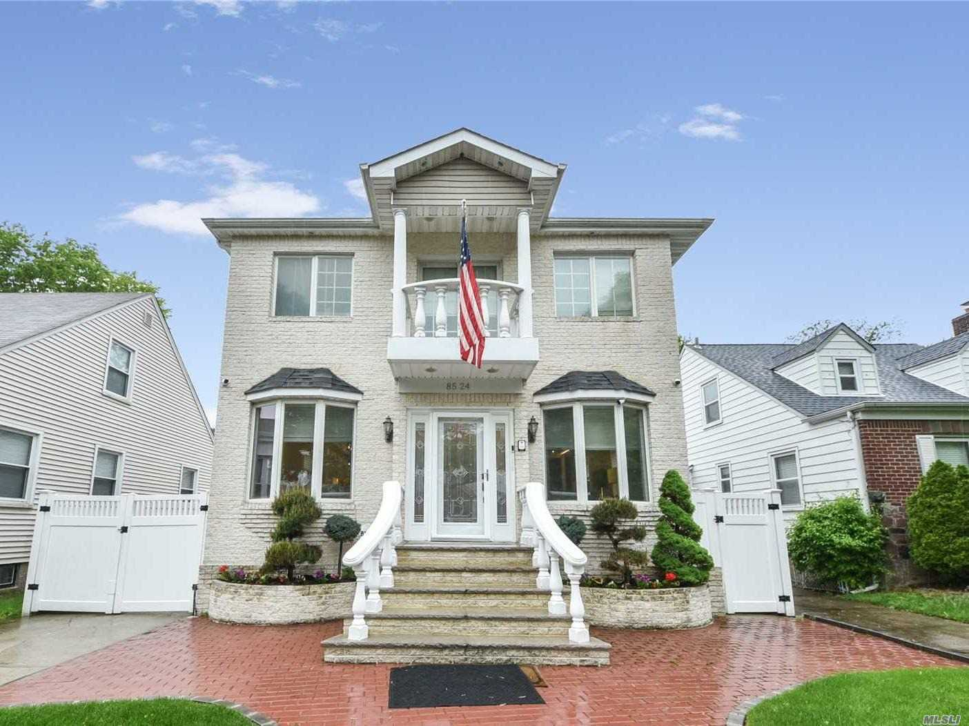 Photo of home for sale at 85-24 250th St, Bellerose NY