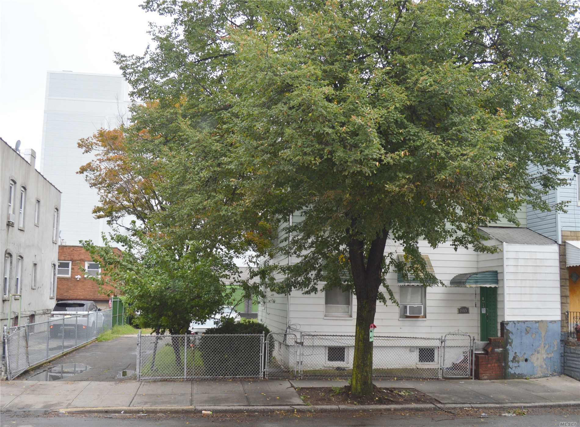 Photo of home for sale at 16-65 George St, Ridgewood NY