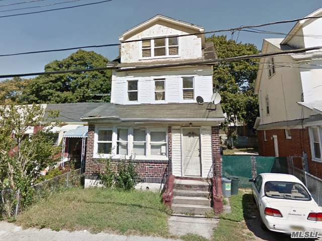 Photo of home for sale at 10727 Watson Pl, Jamaica NY