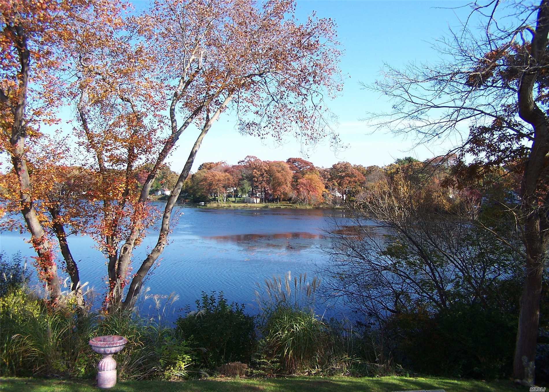 Photo of home for sale at 65 Lake Shore Dr, Patchogue NY