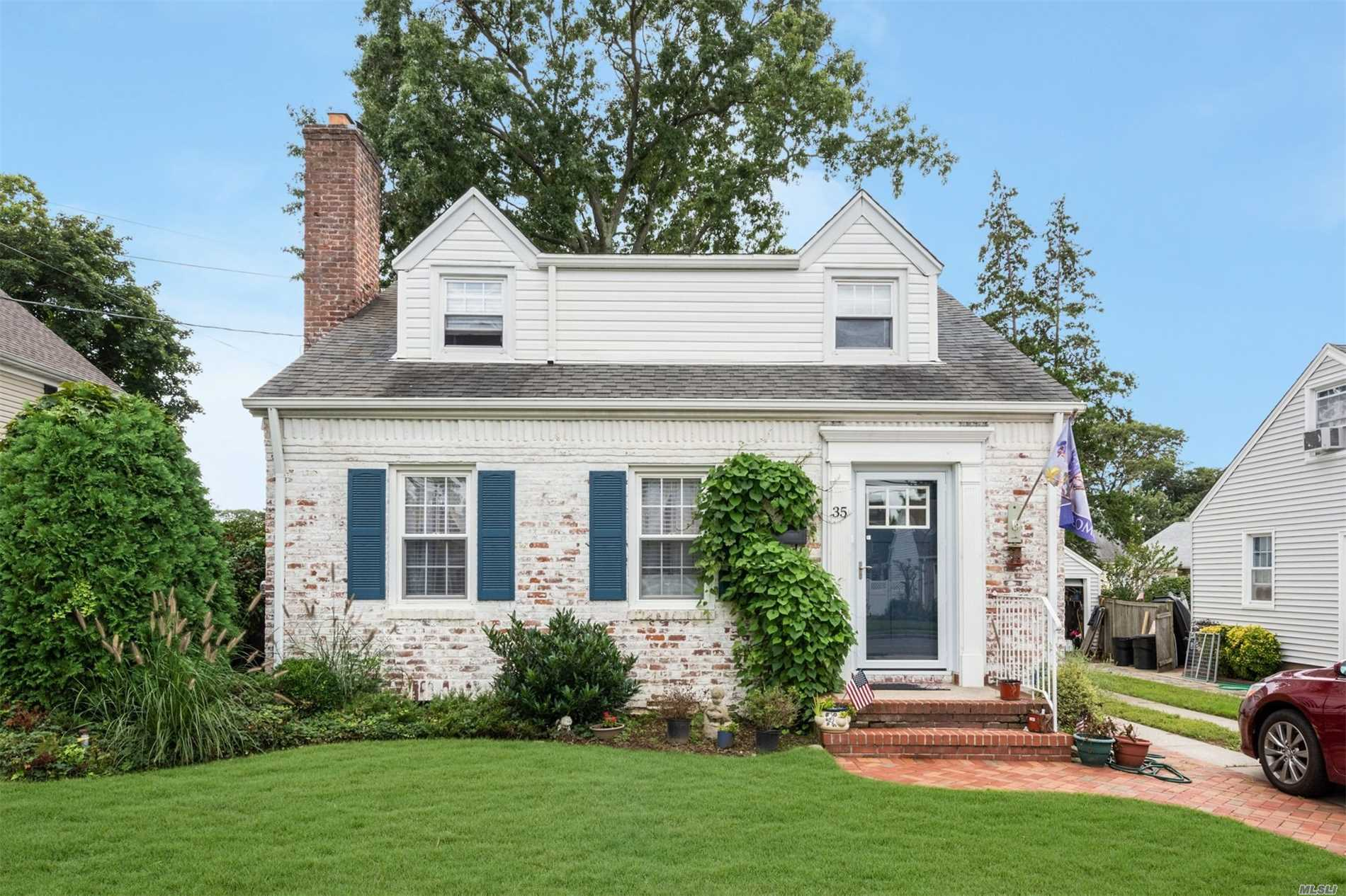 Photo of home for sale at 35 Doncaster Rd, Malverne NY