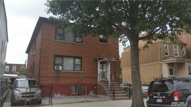 Photo of home for sale at 34-30 107th St, Corona NY