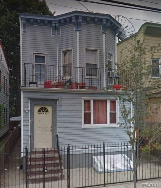 Photo of home for sale at 33-27 98th St, Corona NY
