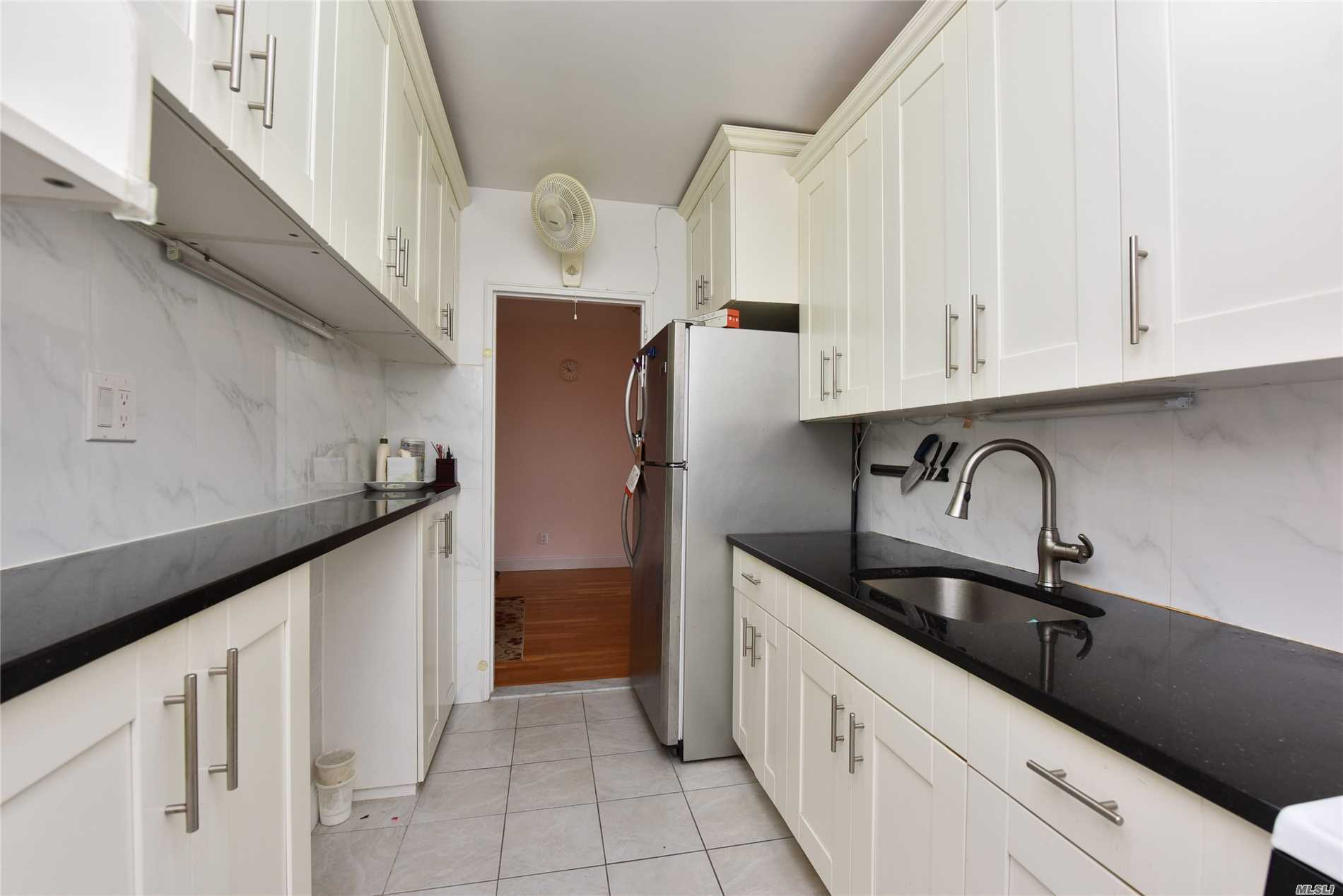 Photo of home for sale at 142-21 26 Ave, Flushing NY