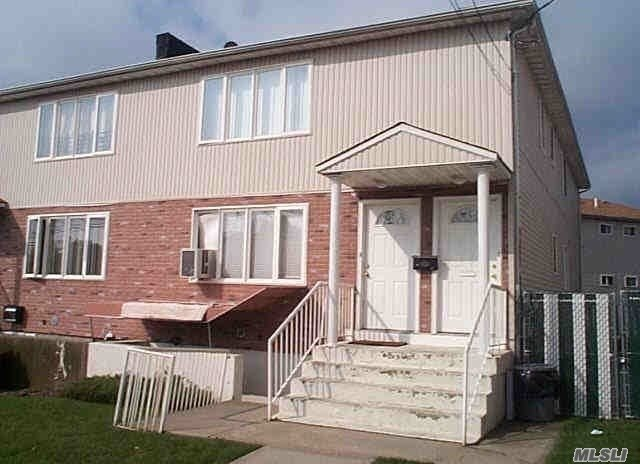Photo of home for sale at 146-64 222nd St, Springfield Gdns NY