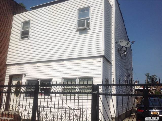 Photo of home for sale at 33-19 103rd St, Corona NY