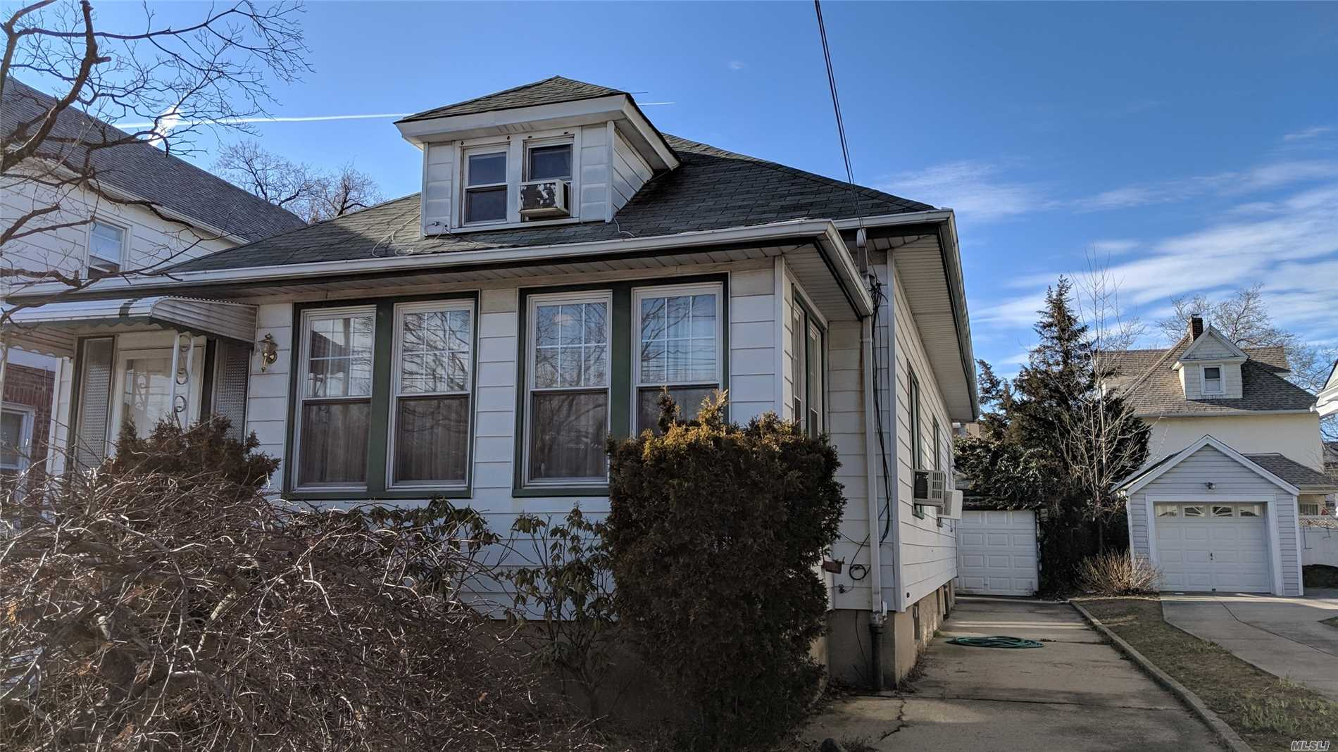 Photo of home for sale at 46-66 157th St, Flushing NY