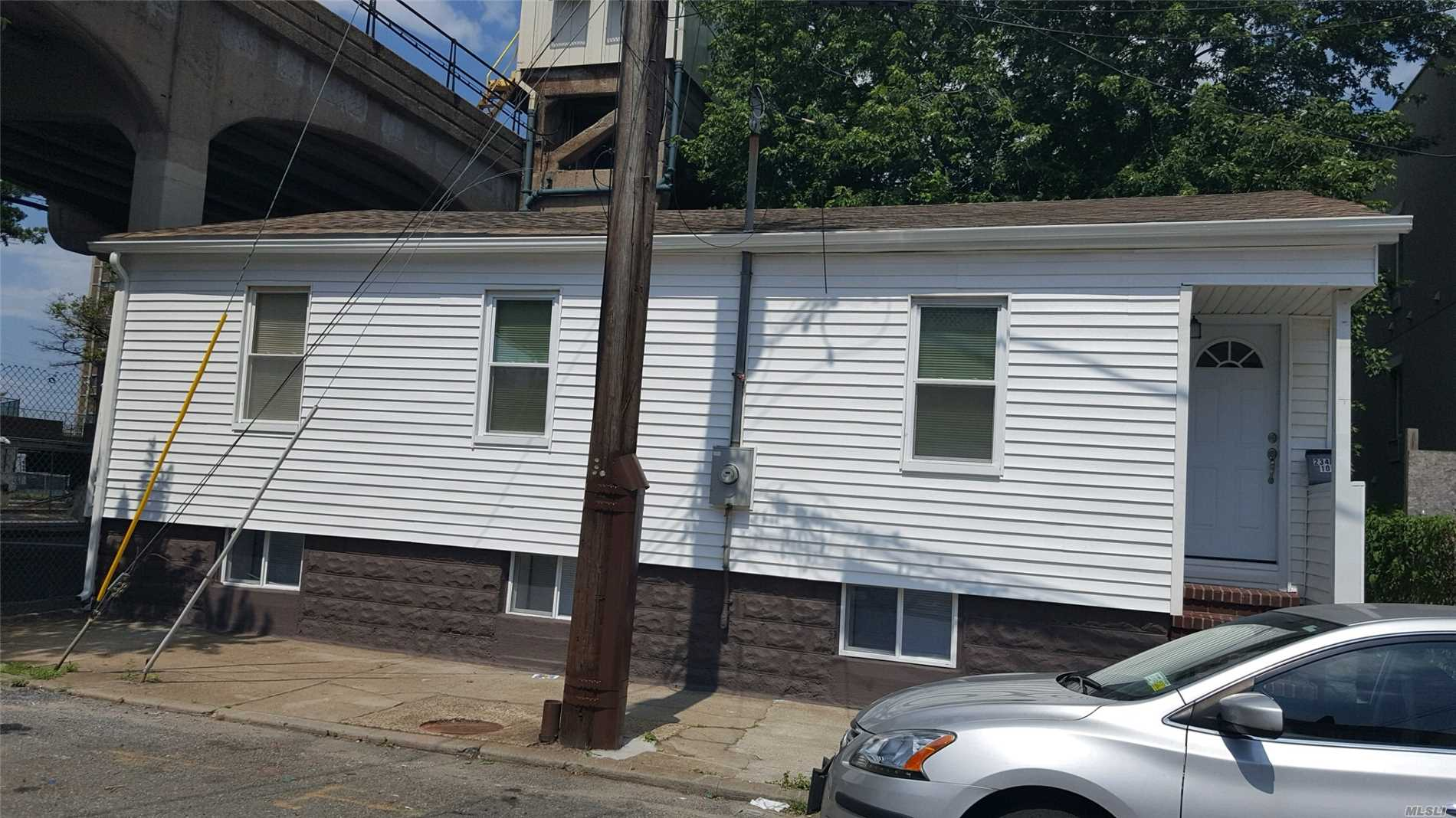 Photo of home for sale at 234 Beach 100th St, Rockaway Park NY