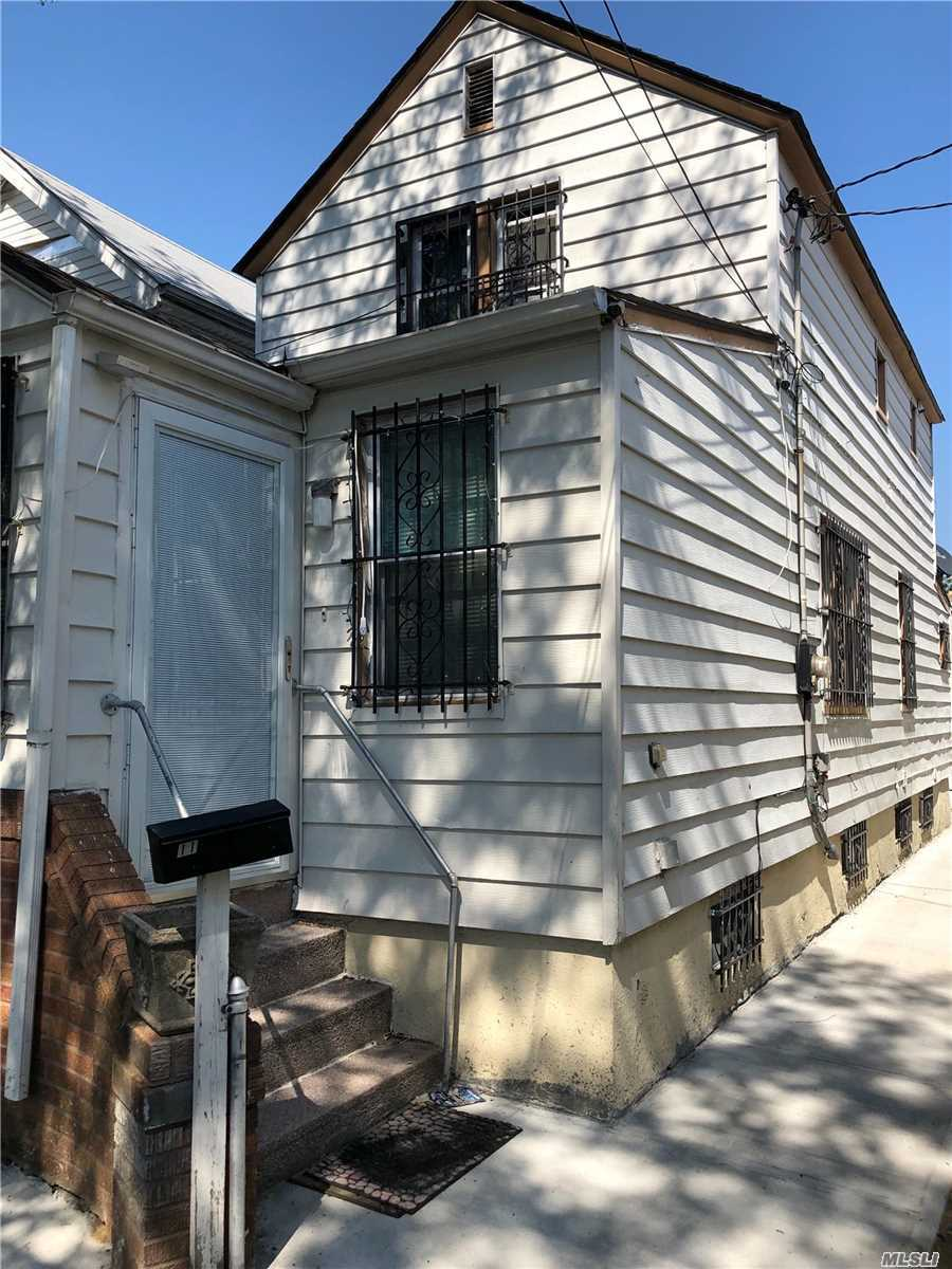 Photo of home for sale at 116-43 126th St, South Ozone Park NY