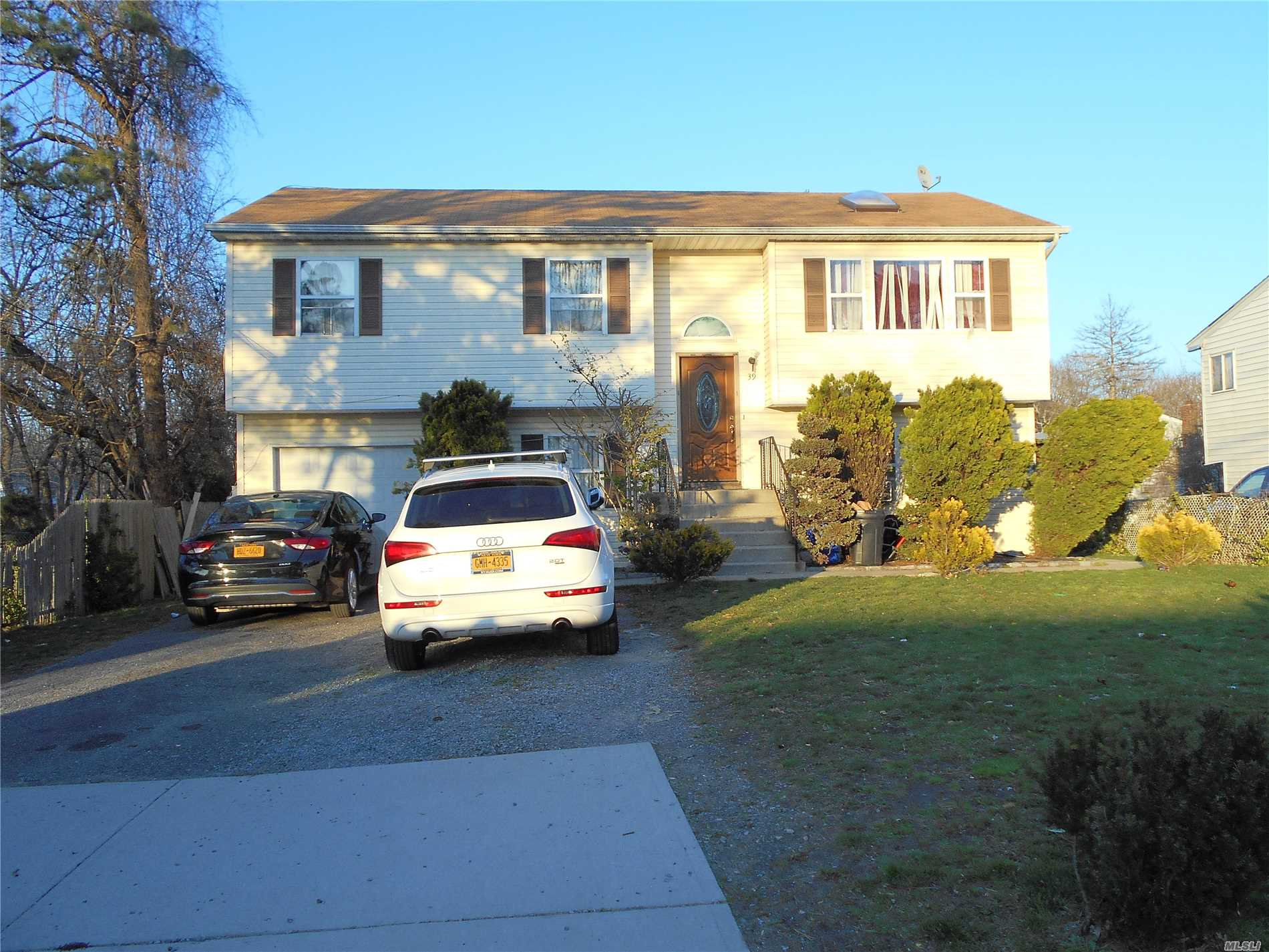 Photo of home for sale at 39 31st St S, Wyandanch NY