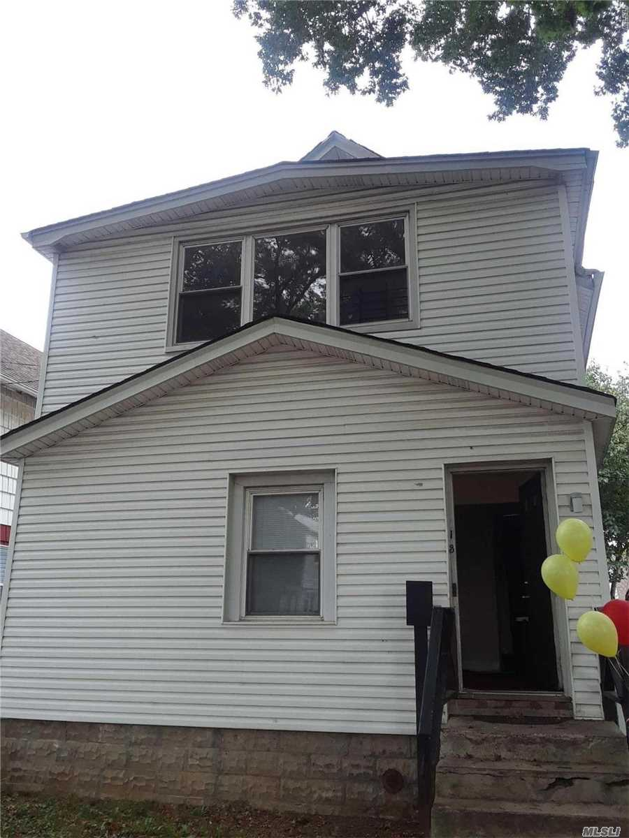 Photo of home for sale at 111-35 141st St, Jamaica NY