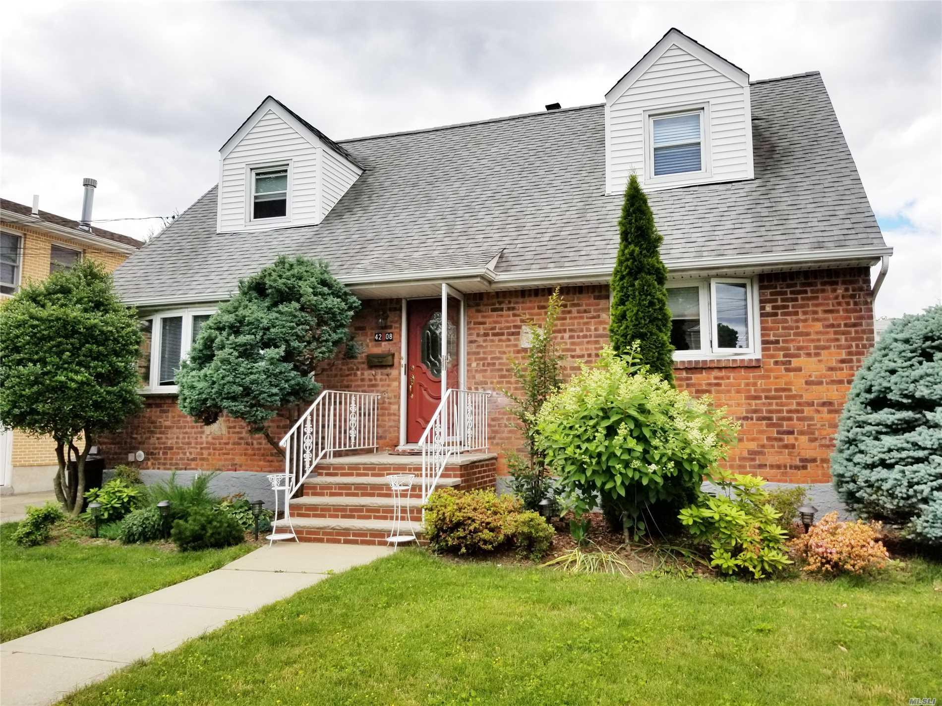 Photo of home for sale at 42-08 218 St, Bayside NY